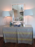 The table is skirted to the floor with 2 shelves underneath for hidden storage!